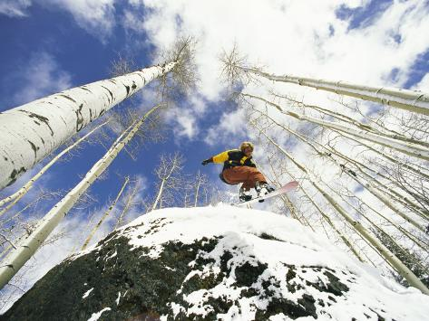 Snowboarder Jumps off a Rock in Telluride, Telluride, Colorado Fotografisk tryk