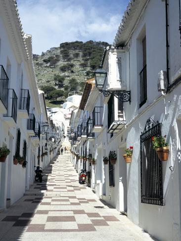 Calle san sebastian a narrow street in mountain village for Calle palma del rio malaga
