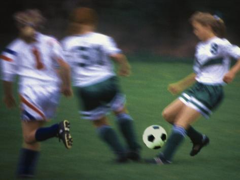 Girls Playing Soccer on a Field Fotografie-Druck