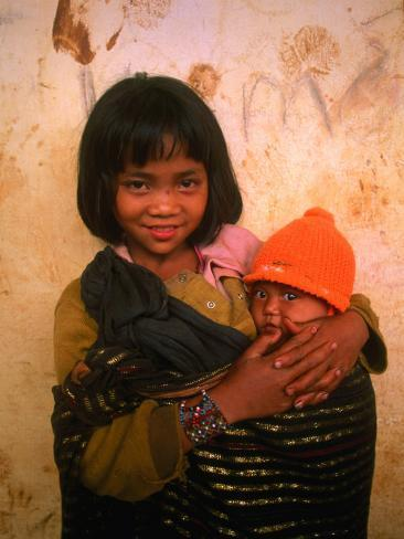 Young Koho Child Holding Baby at