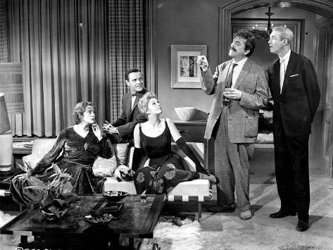 Book Bell Movie Cast Members in Living Room Scene Excerpt from Film Foto