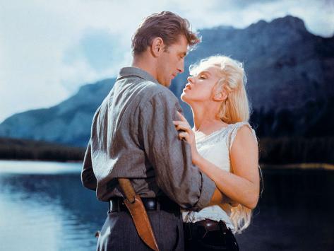 Robert Mitchum, Marilyn Monroe.