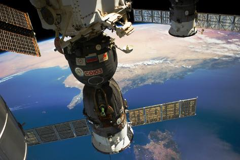 Satellite in space with view of Italy and Africa on Earth Fotografie-Druck