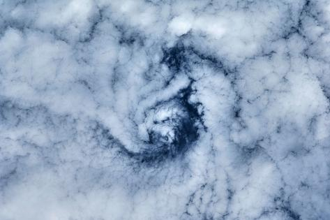 Satellite view of cloud spiral above Earth over Canada Fotografie-Druck