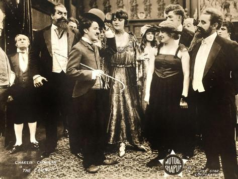 THE COUNT, foreground left: Charlie Chaplin, foreground second from right: Edna Purviance, 1916. Kunstdruck