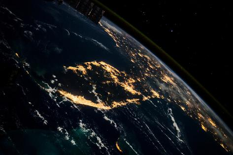 View of planet Earth from space showing night time over Cuba and Florida Fotografie-Druck