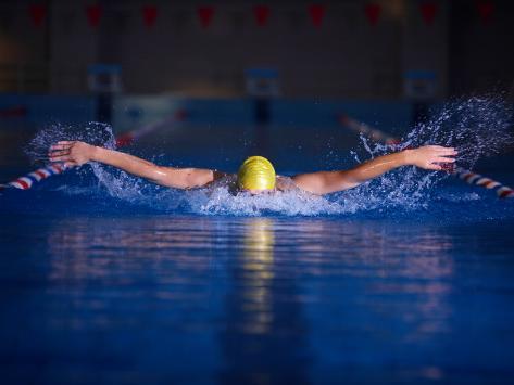 Young Male Swimmer Doing Butterfly Stroke in Swimming Lane Fotografie-Druck