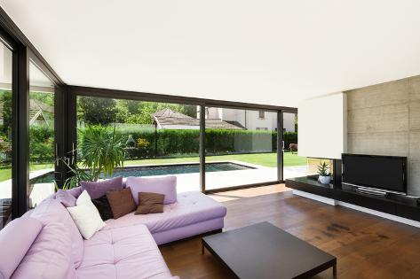 Modern villa interior wide living room with pink divan fotografie