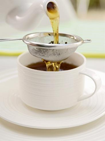 Pouring Tea Through a Tea Strainer 写真プリント