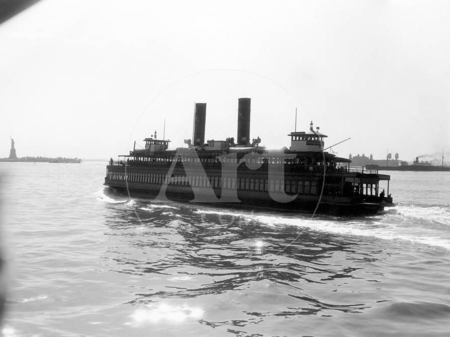 1930s Ferry Boat With Two Smoke Stacks Viewed From The Stern Statue Of Liberty On Horizon New York
