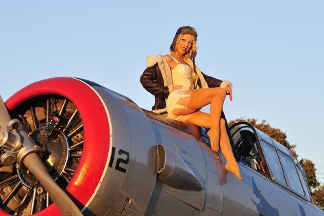オールポスターズの 1940 s style aviator pin up girl posing with a