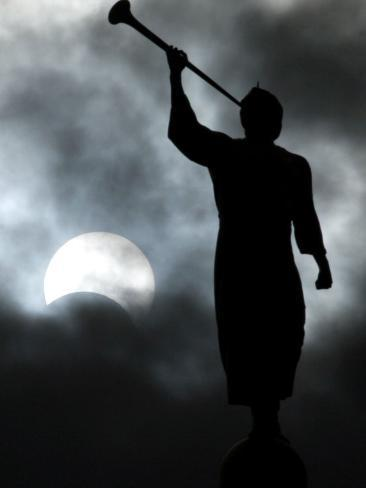 A Statue is Seen against a Cloudy Sky and a Partial Solar Eclipse Photographic Print