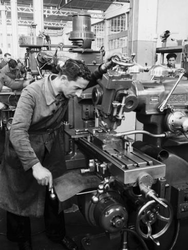 Worker Working at Various Machines in the Innocenti Automobile Factory Photographic Print
