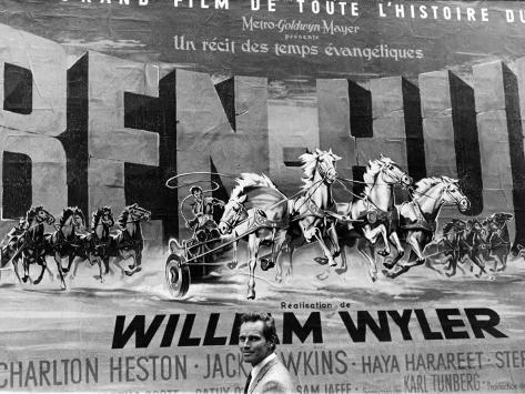Actor Charlton Heston Posing in Front of Billboard of Film, Ben Hur Premium Photographic Print
