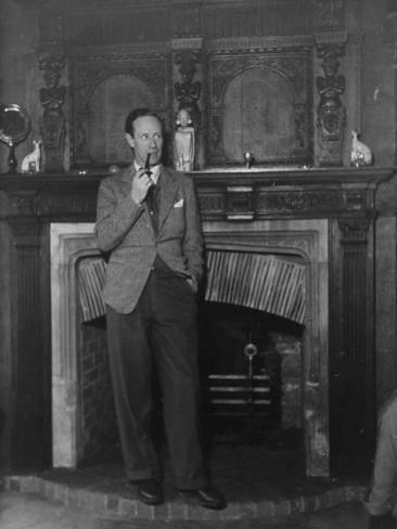 Actor Leslie Howard Smoking Pipe as He Stands by His Fireplace, at Home in Dorking, England Premium Photographic Print