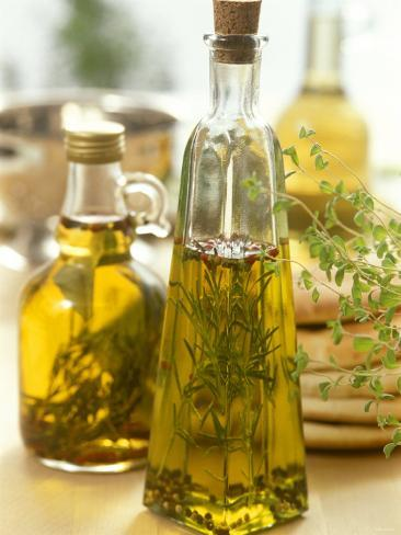 Oil with Herbs and Spices in Two Bottles Photographic Print