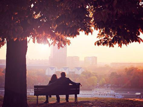 Romantic Couple on a Bench by the River Photographic Print