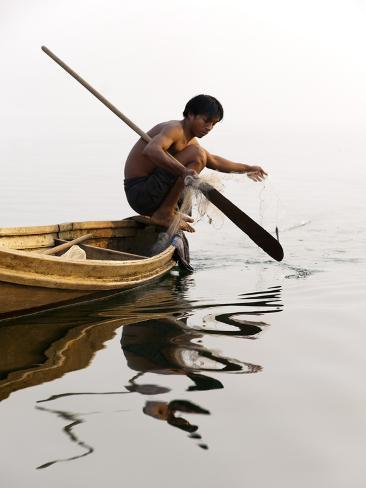 A Man Pulls in His Net on Indawgyi Lake, Northern Myanmar Photographic Print