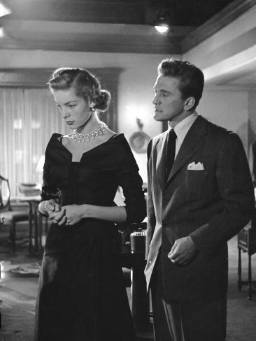 Actors Lauren Bacall and Kirk Douglas in