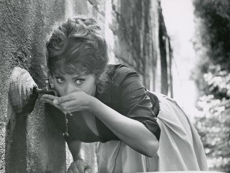Actress Sophia Loren Drinking Water from Spigot During the Filming of Madame Sans Gene Premium Photographic Print