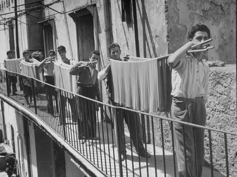 Boys Working in Pasta Factory Carry Rods of Pasta to Drying Rooms Photographic Print