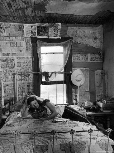 Farmer's Daughter Delphaline, Reading a Book as She Lies on Iron Bed in Her Bedroom Photographic Print