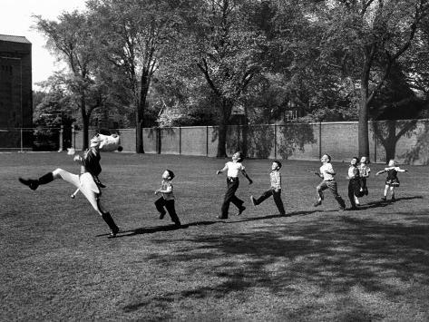 Uniformed Drum Major For University of Michigan Marching Band Practicing His High Kicking Prance Photographic Print