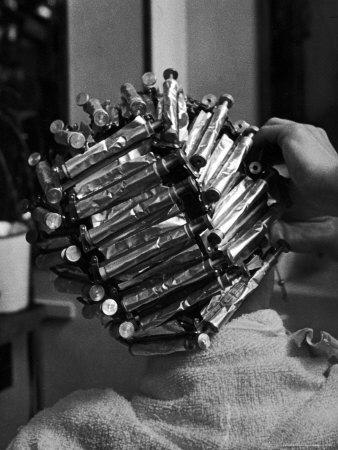 Woman At Beauty Salon In Curlers And Tinfoil For Permanent