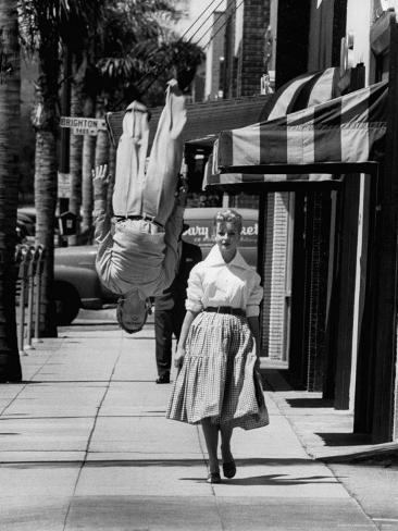 Acrobat and Actor, Russ Tamblyn Doing a Flip on the Sidewalk with Starlet Venetia Stevenson Premium Photographic Print