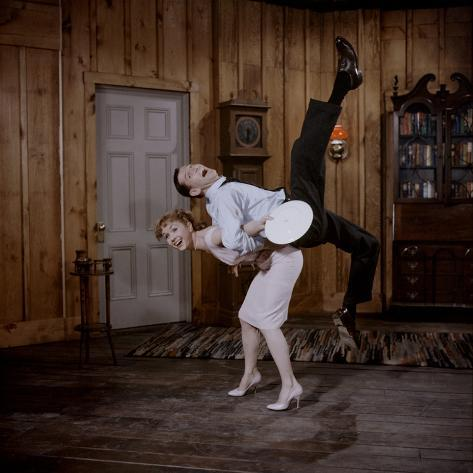 Debbie Reynolds Lifts Fellow Actor Tony Randall in a Scene from 'The Mating Game', 1959 Photographic Print