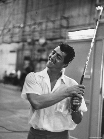 Singer and Actor Dean Martin holding a pitching club on Movie Set for MGM's