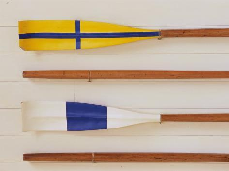 An Array of boat oars Mounted on a wall Photographic Print