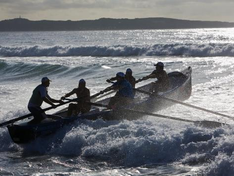 New South Wales, A Surfboat Crew Battles Through Waves at Cronulla Beach in Sydney, Australia Photographic Print