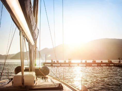 Sailboat on Sunset, Luxurious Water Transport, Bright Sun Light on the Sea, Evening Travel on Sail Photographic Print
