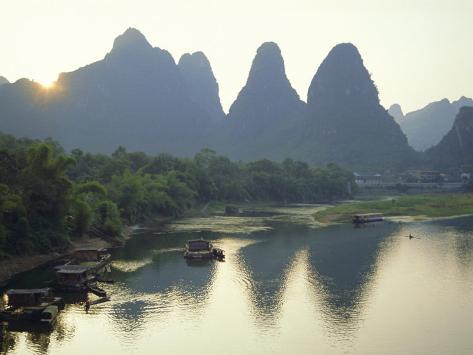 In Guilin Limestone Tower Hills Rise Steeply Above the Li River, Yangshuo, Guangxi Province, China Photographic Print