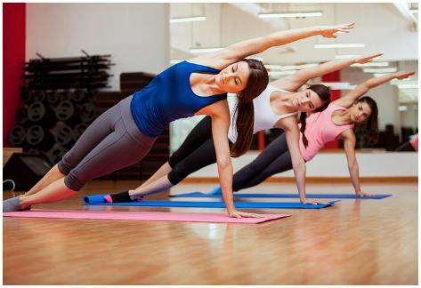 Side Plank Yoga Pose By Three Women Póster
