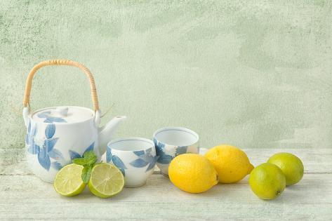Citrus Fruit Still Life Against a Grunge Textured Valokuvavedos