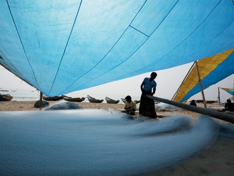 Fishermen Repairing their Nets under Shade of Sail Photographic Print