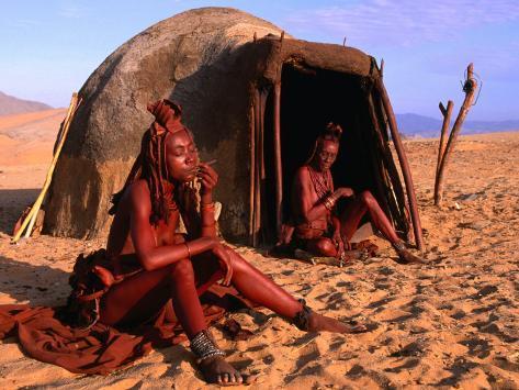 Himba Women in Front of Traditional Hut, Kaokoveld, Kunene, Namibia Photographic Print