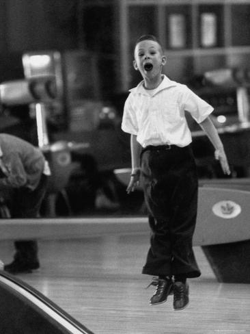 Child Bowling at a Local Bowling Alley Photographic Print