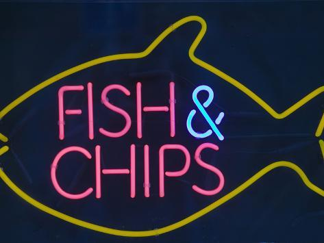 A Neon Fish and Chips Sign Photographic Print