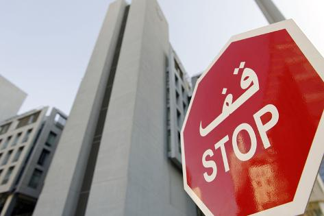 Stop Sign in Front of Modern Architecture in the Financial District, Dubai, United Arab Emirates Photographic Print