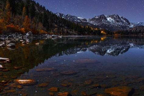 The Night Sky over a Moonlit Autumn Landscape with Reflections in a Calm Lake Photographic Print