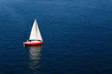 A Lone White Sail on a Calm Blue Sea Photographic Print