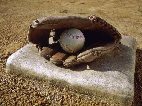 Baseball in a Baseball Glove on a Base Photographic Print