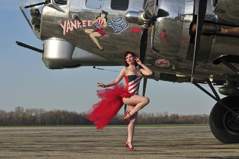 Beautiful 1940's Style Pin-Up Girl Standing in Front of a B-17 Bomber Photographic Print