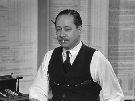 Writer Robert Benchley, Sitting at His Desk with a Small Wade of Paper in His Mouth Premium-valokuvavedos