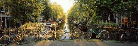 Bicycles on Bridge Over Canal, Amsterdam, Netherlands Photographic Print
