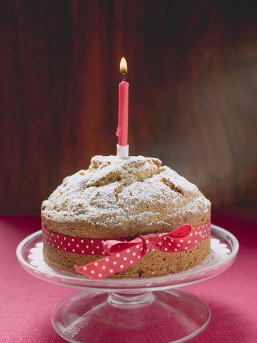 Birthday Cake with Red Bow and Burning Candle Stretched Canvas Print