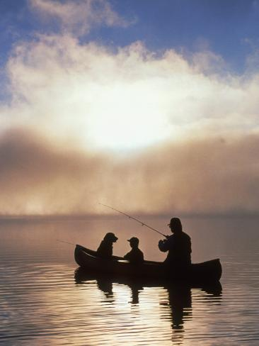 Silhouetted Father and Son Fishing from a Canoe Photographic Print